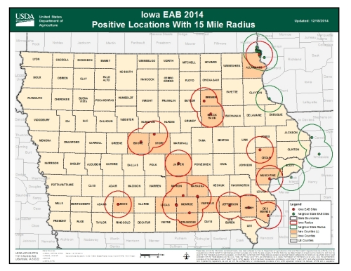 Locations of confirmed infestations of the emerald ash borer in Iowa.  The red dots indicate the approximate location of a confirmed detection; the red circles indicate a 15-mile radius around known infestations within Iowa.  The 15-mile radius is a guid