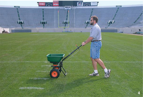 Overseeding an athletic field.